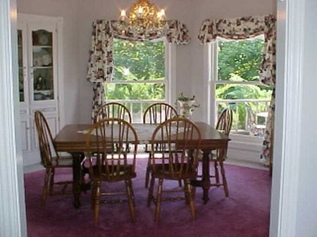 Dinner is served in style in the formal dining room that includes chandelier and built in china hutch.  Gazing over the gardens makes dining even more pleasant.