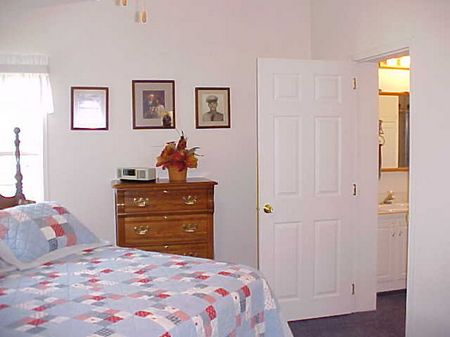 Large, cheery and bright master suite with 3/4 bath including a  linen closet and walk-in clothes closet, plus regular closet inside the bedroom