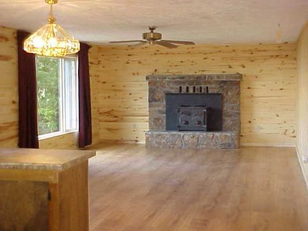 Big windows, amazing views, pine tongue & groove walls, new Pergo flooring, moss rock fireplace....the list goes on and on! A wrap around deck for summer enjoyment plus a covered patio! Timberline woodstove insert in the fireplace stays!