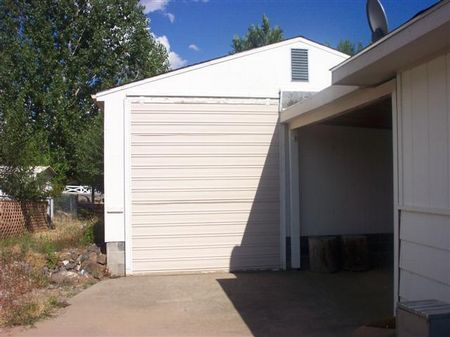 HUGE second garage is attached via a breezeway and is designed for RV storage.  Inside this garage you will also find a very large shop and TWO root cellars for your canned goods and abundant storage areas.